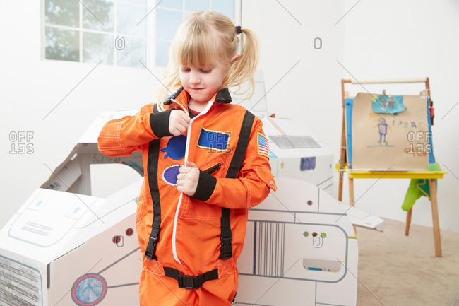 Young girl wearing astronaut costume
