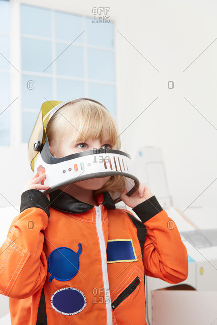 Young girl pretending to be an astronaut