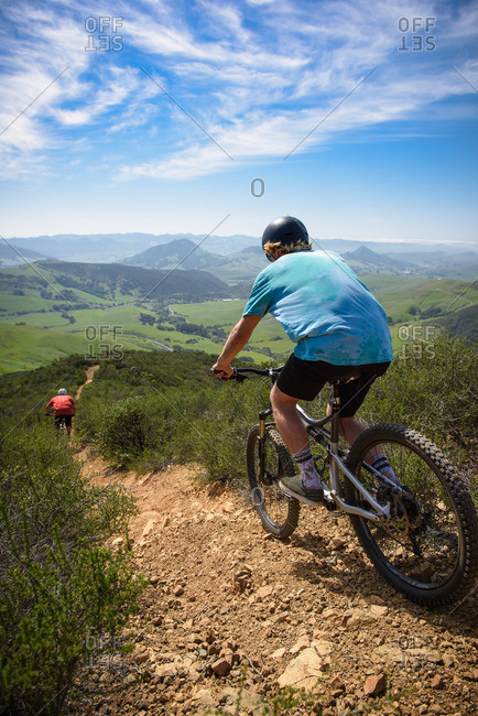 Cyclists mountain biking, San Luis Obispo, California, United States of America