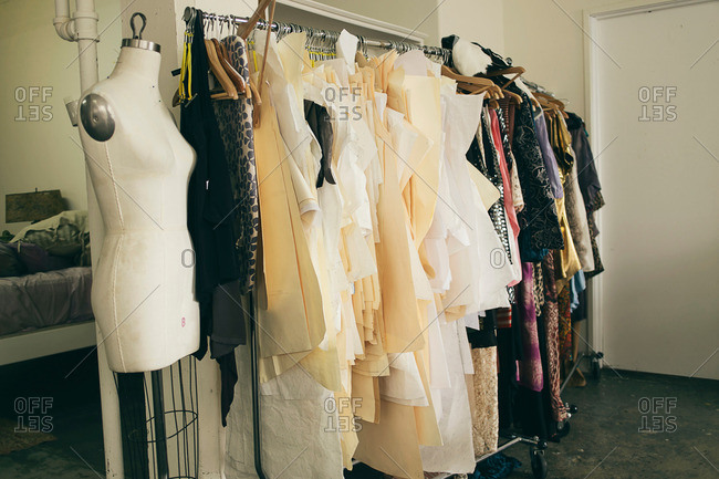 Tailors dummy and clothes rail in fashion studio