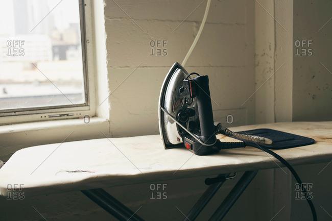 Iron and ironing board in fashion studio