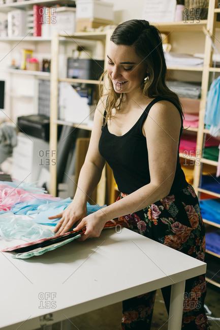 Female textile designer matching textiles in design studio