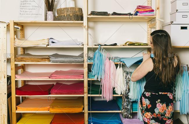 Female textile designer selecting textiles in design studio