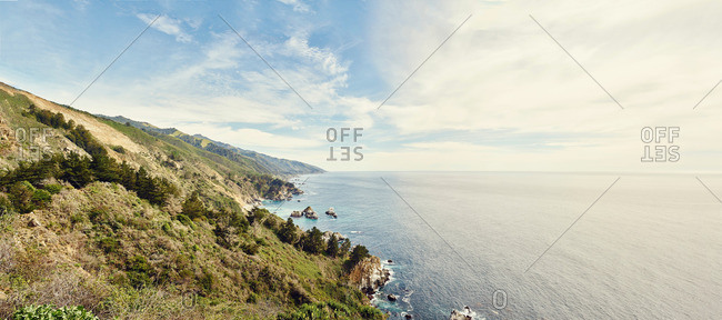 Panoramic view of sunlit coastline and sea, Big Sur, California, USA