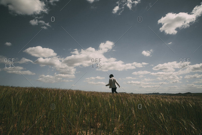 Girl wandering in high grass