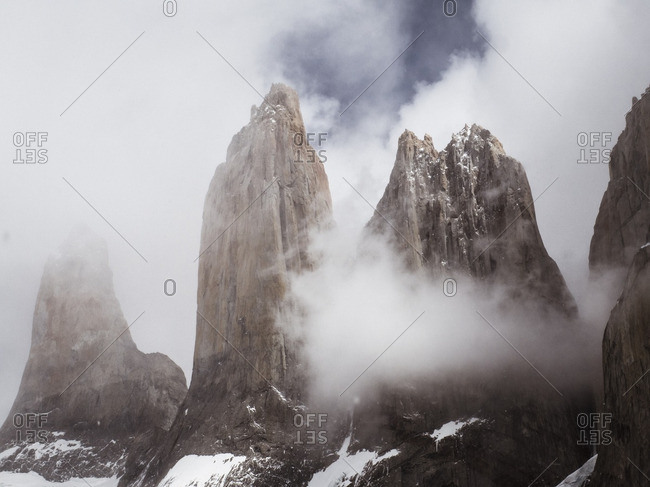 Spires of rock surrounded by clouds