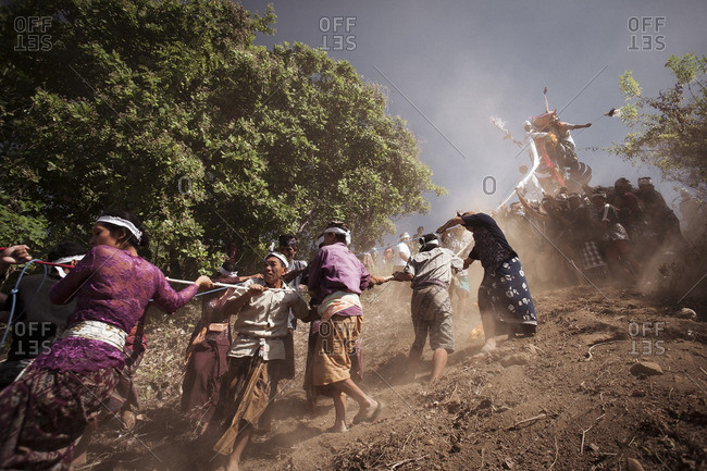 Bali - August 27, 2010: Men carrying the remains of a dead person in the Ngaben ceremony of the death