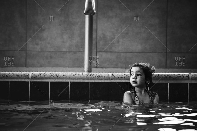 Little girl swimming in an indoor pool
