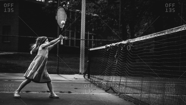 Little girl playing tennis - from the Offset Collection