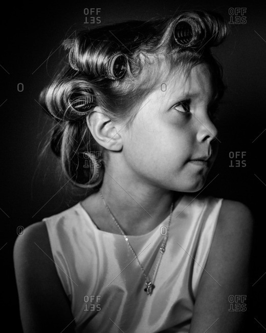 Portrait of a little girl with rollers in her hair