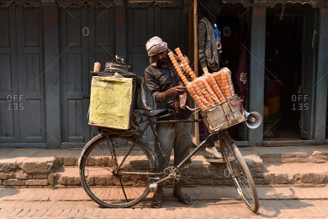 Bhaktapur, Nepal - April 13, 2016: Man selling ice cream from his bicycle in Bhaktapur, Nepal