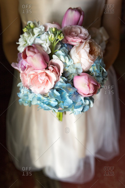 Bride holding a colorful bouquet of hydrangea and tulips