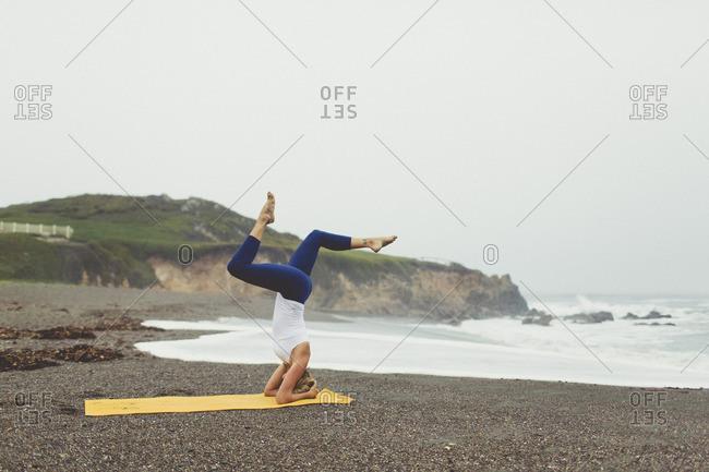 Woman in balance pose on beach
