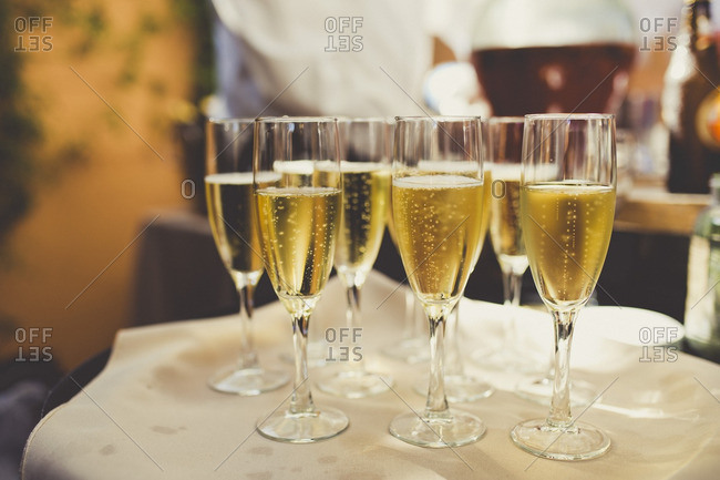 Wedding champagne glasses on tray