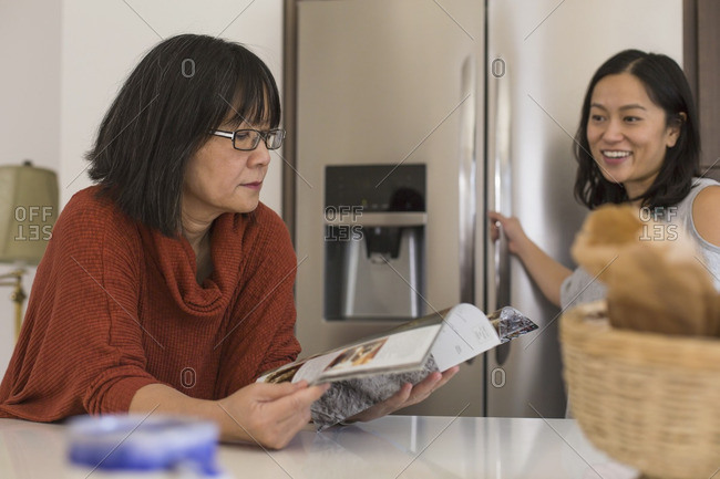 Two women having conversation in a kitchen