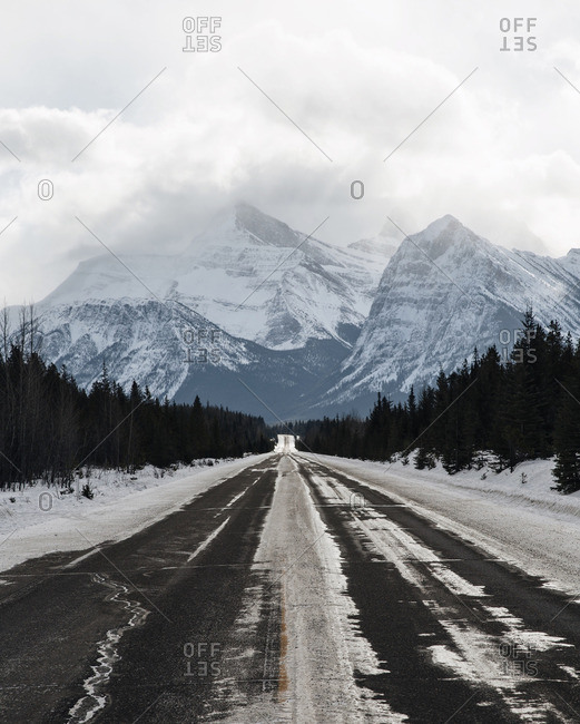 Wintery road leading to mountains