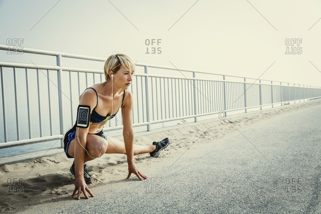 Woman stretching outdoors before a workout
