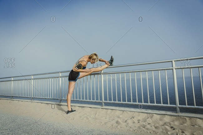 Woman stretching outdoors before a run