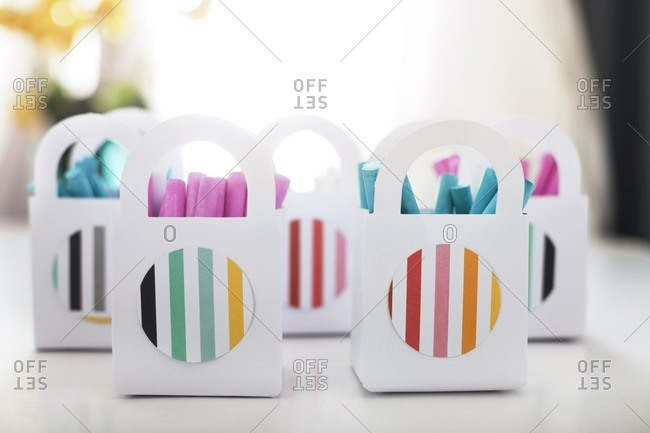 Colorful chalks in paper bags on table