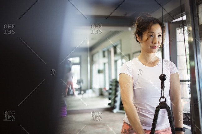 Front view of woman exercising in gym