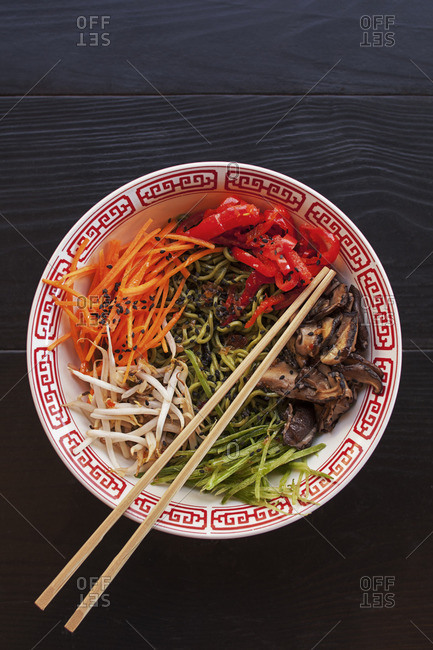Overhead view of sesame noodles served on table