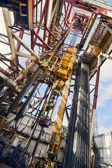 Low angle view of drilling rig at oil industry