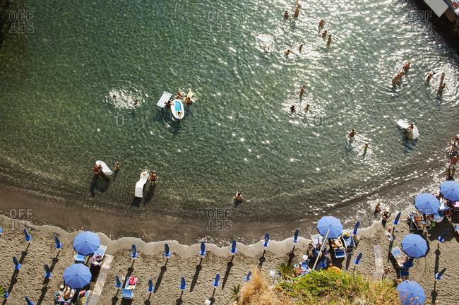 Overhead view of people enjoying in sea