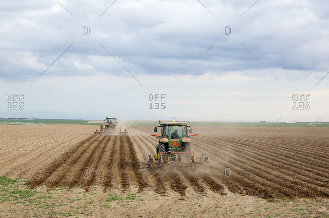 Tractors cultivating a field in the Palouse region, Washington