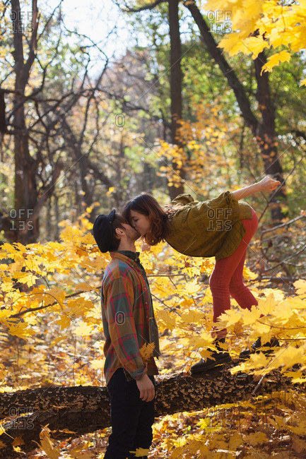 Happy young couple kissing in a park