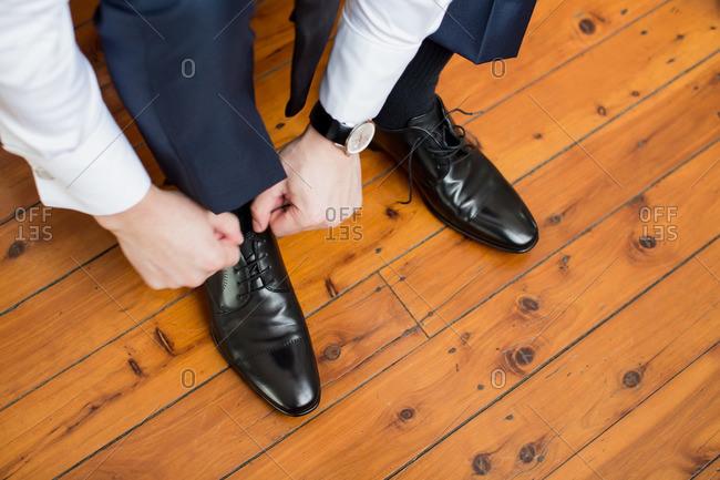 Man tying his shoe