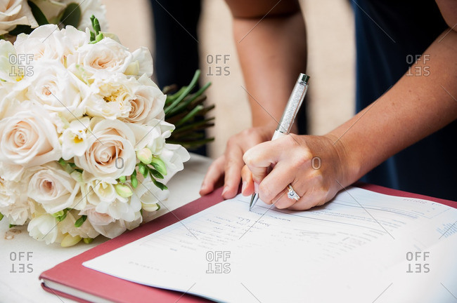 Woman signing a guest book at a wedding