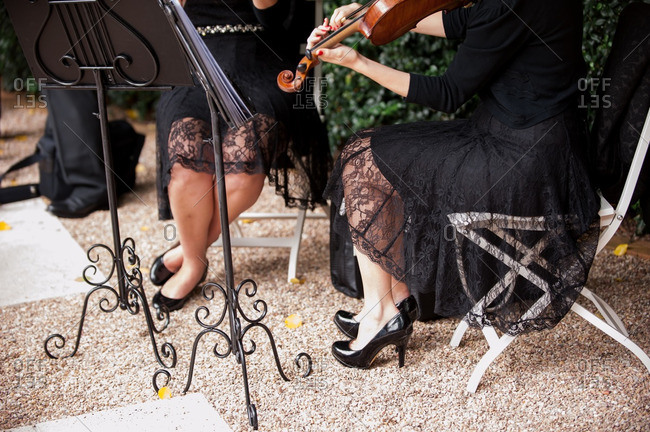Musicians playing at an outdoor wedding