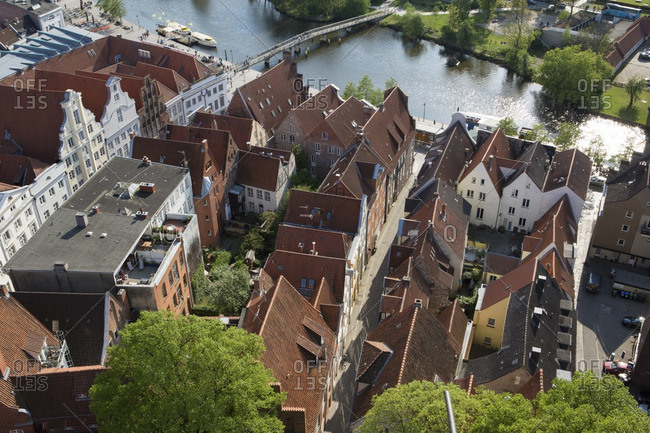 Aerial view of old city buildings on the riverfront in Lubeck, Germany