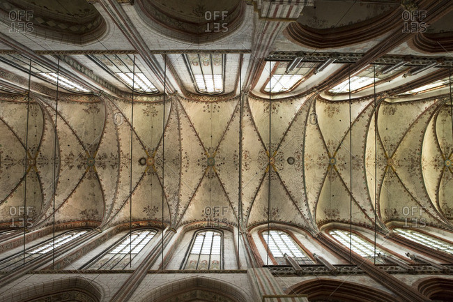 Lubeck, Germany. - May 13, 2016: Painted ceiling and arched windows of St. Mary's Church