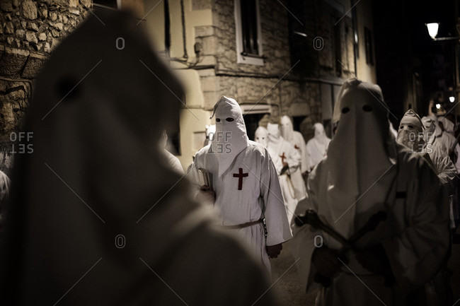 Penitents walk during a Good Friday procession
