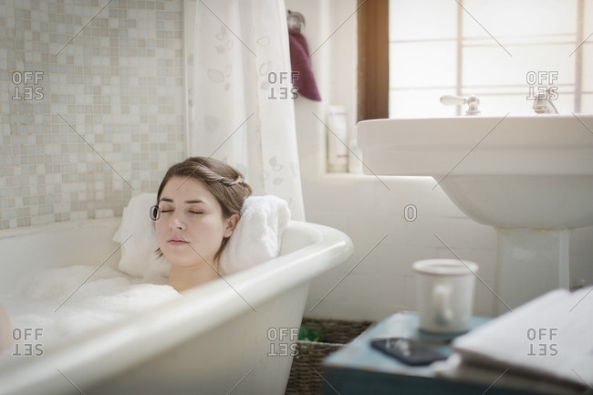 Young woman relaxing in a bathtub