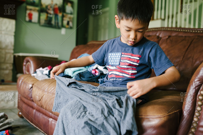 Boy helping fold the laundry