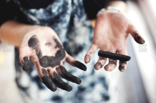 Woman's charcoal-stained hands - Offset Collection