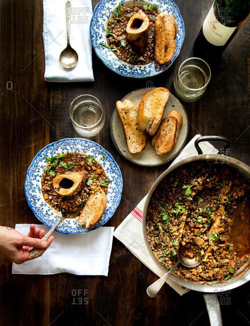 Lentil stew with roasted bone marrow