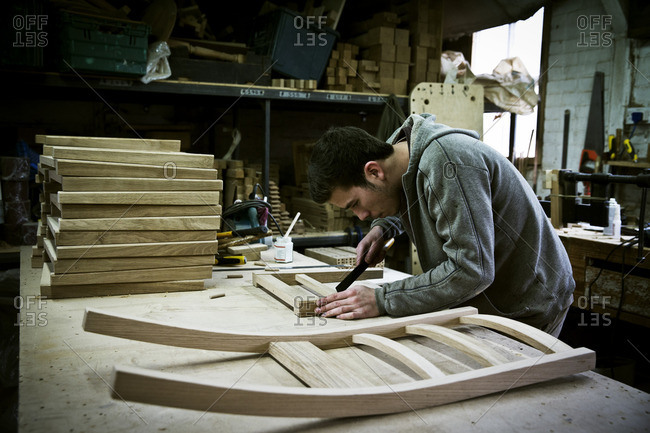 A man working in a furniture maker's workshop