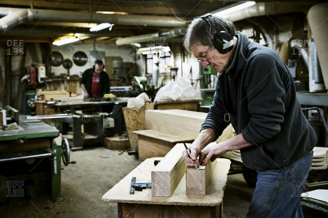 A man working in a furniture maker's workshop