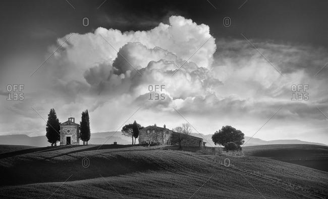 January 24, 2015: Storm clouds over Vitaleta in Tuscany, Italy