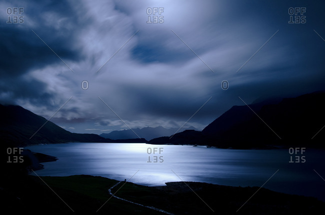 Moonlight on Mont Cenis lake in the Haute-Maurienne valley in Savoie, France