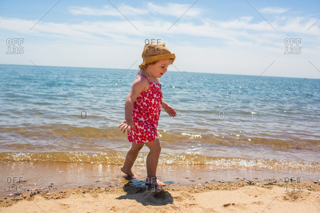 Toddler girl playing on a beach