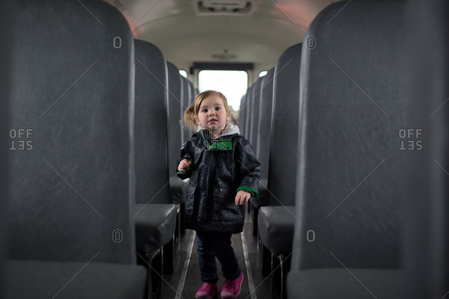 Little girl riding on a bus