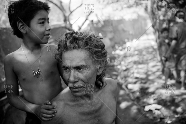 Managua, Nicaragua - January 24, 2009: Young boy with father at the La Chureca