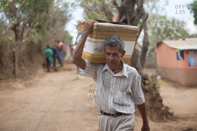 Managua, Nicaragua - April 30, 2009: Man carrying cooler on his shoulders