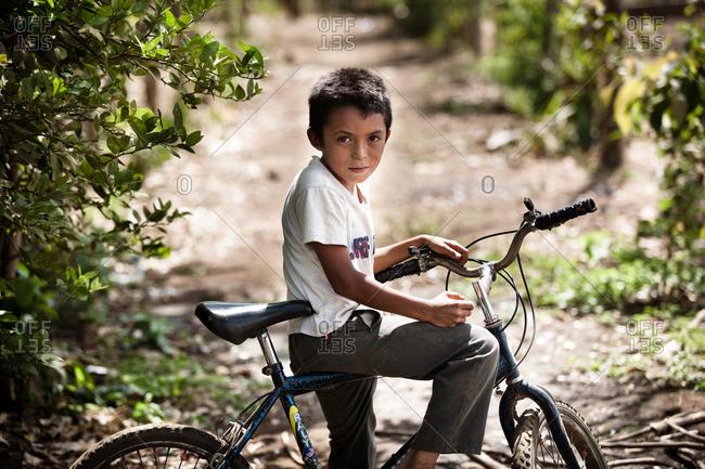 Managua, Nicaragua - April 30, 2009: Boy riding bicycle