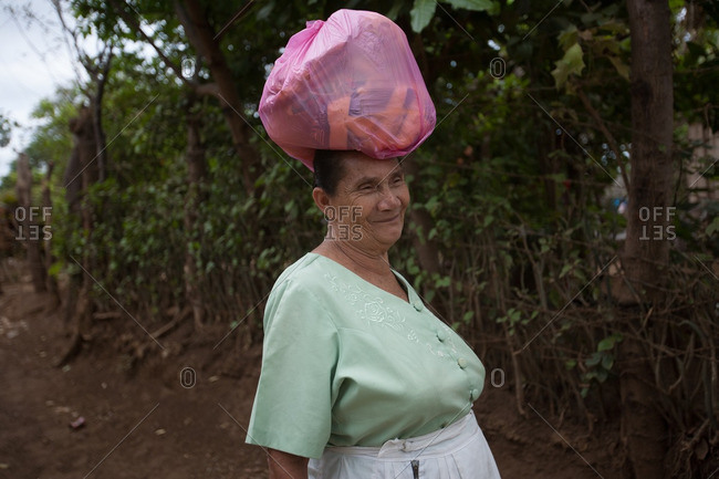 Managua, Nicaragua - April 30, 2009: Woman carrying bag on top of her head