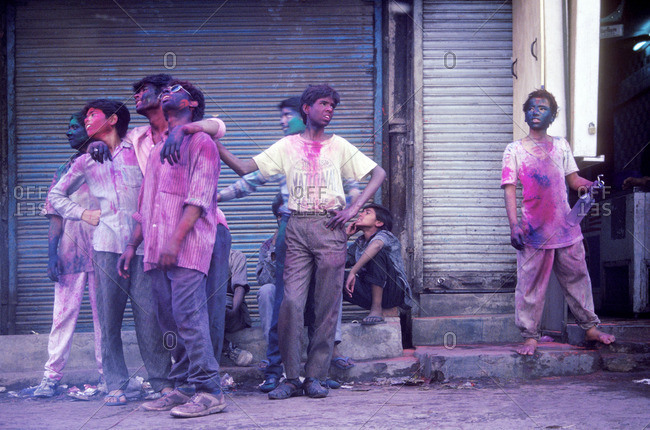 New Delhi, India - March 26, 1994: Hindu teenagers look up at the rooftops during the Holi festival